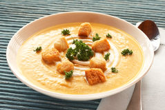 Bowl of fresh butternut soup. Bowl of fresh hot butternut soup with cream, parsley and croutons Royalty Free Stock Photography