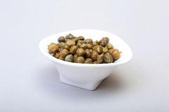 Bowl with fresh capers isolated on white background. Bowl with fresh capers isolated on white background Stock Photography