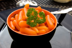 Bowl with fresh carrots Stock Photos