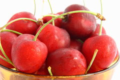 Bowl of fresh cherries. A bowl of freshly picked cherries on a white background Royalty Free Stock Photo