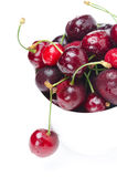 Bowl of fresh cherries on a white background, selective focus Stock Image