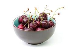 Bowl of fresh cherries. On a white background, studio isolated Stock Photo