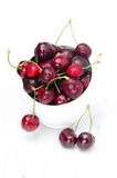 Bowl of fresh cherries on a white background Stock Photos
