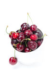 Bowl of fresh cherries on a white background, vertical Stock Image