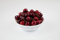 Bowl of fresh cherry. A bowl of fresh cherry isolated on white Royalty Free Stock Photo
