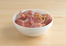 Bowl of fresh chicken gizzards and hearts Stock Photo
