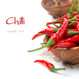 Bowl with fresh chili peppers, selective focus, isolated Stock Photo