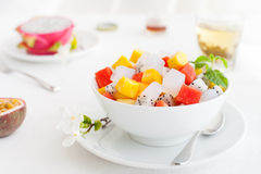 Bowl of fresh exotic fruit salad Healthy breakfast Royalty Free Stock Photography