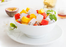 Bowl of fresh exotic fruit salad Healthy breakfast Royalty Free Stock Images
