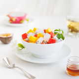 Bowl of fresh exotic fruit salad Healthy breakfast Stock Photos
