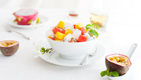 Bowl of fresh exotic fruit salad on white summer background Healthy breakfast stock photos