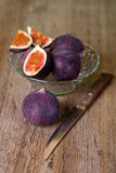 Bowl with fresh figs and old knife Stock Photo