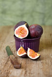 Bowl with fresh figs and old knife Royalty Free Stock Image