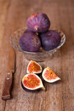 Bowl with fresh figs and old knife Royalty Free Stock Photo