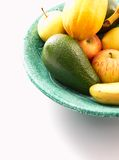 Bowl of fresh fruit. Green bowl of fresh fruit on a white background stock photography