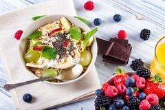 Bowl of fresh fruit. Bblackberries; raspberries; blueberries on. A bowl. Healthy breakfast. Vegetarian organic meal Stock Photography