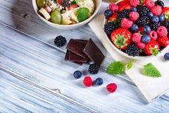 Bowl of fresh fruit. Bblackberries; raspberries; blueberries on. A bowl. Healthy breakfast. Vegetarian organic meal Royalty Free Stock Photos