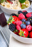Bowl of fresh fruit. Bblackberries; raspberries; blueberries on. A bowl. Healthy breakfast. Vegetarian organic meal Royalty Free Stock Photography