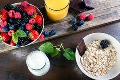 Bowl of fresh fruit. Bblackberries; raspberries; blueberries on. A bowl. Healthy breakfast. Vegetarian organic meal Stock Image