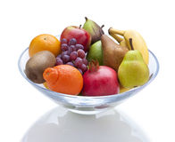 Bowl Fresh Fruit Food. A glass bowl of fruit on a white background with a reflection Royalty Free Stock Images
