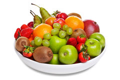 Bowl of fresh fruit isolated on white royalty free stock image