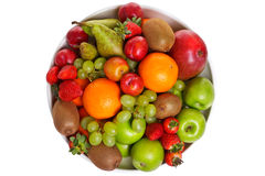 Bowl of fresh fruit isolated on white Stock Images