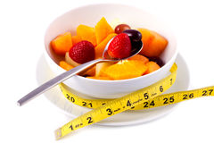 Bowl of Fresh Fruit Salad With Tape Measure Stock Photos