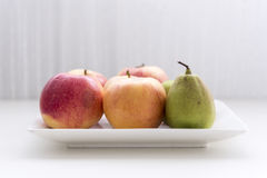Bowl of fresh fruit. On the table stock photo