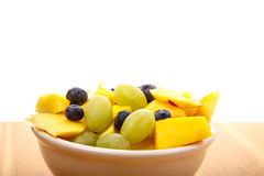 Bowl of Fresh Fruit on Wood Table Royalty Free Stock Photos