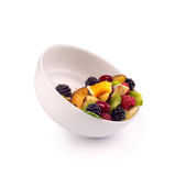 Bowl with fresh fruits salad and berries Stock Image