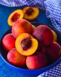 Bowl of fresh fruits sliced and whole Royalty Free Stock Photography