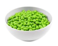 Bowl with fresh green peas. On white background Royalty Free Stock Photos