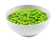 Bowl with fresh green peas. On white background Stock Photography