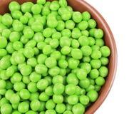 Bowl with fresh green peas on white background. Closeup Stock Image