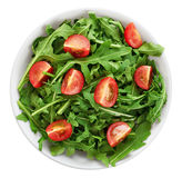 Bowl with fresh green salad arugula and tomatoes isolated on whi Royalty Free Stock Image