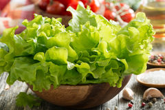 bowl with fresh green salad, vegetables and olive oil Stock Photos