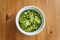 Bowl of fresh guacamole in flat lay composition royalty free stock images