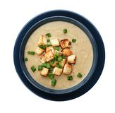 Bowl of fresh homemade mushroom soup. On white background, top view royalty free stock image