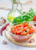 Bowl of fresh homemade salsa dip and ingredients Stock Photography