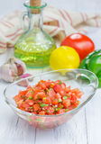 Bowl of fresh homemade salsa. And ingredients Royalty Free Stock Images