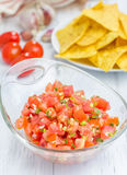 Bowl of fresh homemade salsa and nachos. Closeup Stock Photo