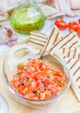Bowl of fresh homemade salsa with quesadilla. Closeup Royalty Free Stock Images