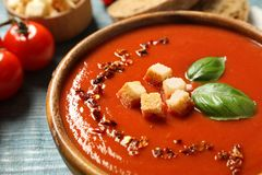 Bowl with fresh homemade tomato soup on table. Closeup royalty free stock photography