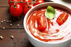 Bowl with fresh homemade tomato soup on table, closeup. Space for text stock photography