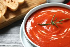 Bowl with fresh homemade tomato soup on table, closeup. Space for text royalty free stock images