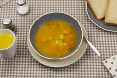Bowl of fresh homemade vegetable soup on a kitchen table Stock Image