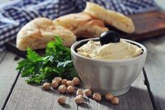 Bowl of fresh hummus Stock Image