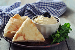 Bowl of fresh hummus Stock Photo