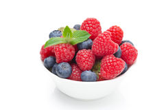 Bowl with fresh juicy berries, isolated. On white Stock Images