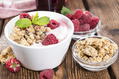 Bowl with fresh made Raspberry Yogurt. And some fruits Royalty Free Stock Photography